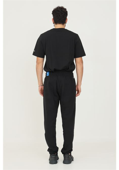 Sweat pants adicolor shatteres trefoil uomo nero adidas ADIDAS | Pantaloni | H35651.