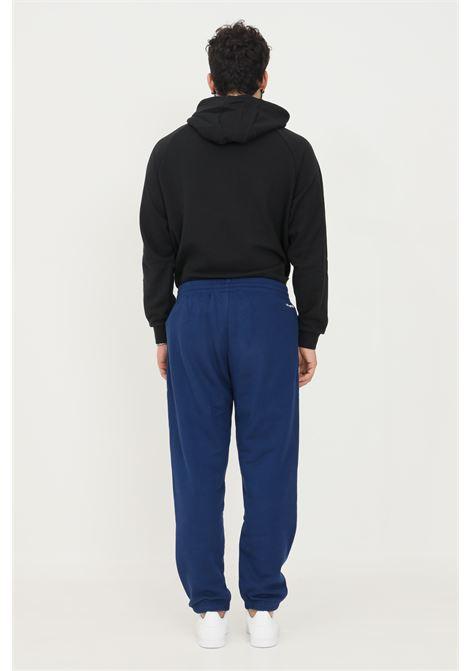 Pantaloni sweat pants adicolor shattered trefoil uomo blu adidas ADIDAS | Pantaloni | H37727.