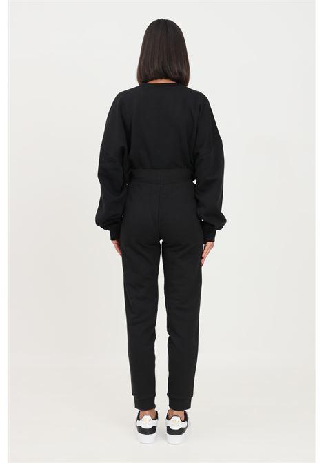 Pantaloni adicolor essentials slim donna nero adidas ADIDAS | Pantaloni | H37878.