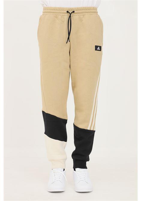 Pantaloni uomo beige adidas sport modello slim ADIDAS | Pantaloni | H39762.