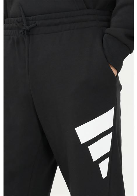 Pantaloni adidas sportswear future icons logo graphic uomo nero sport ADIDAS | Pantaloni | H39796.