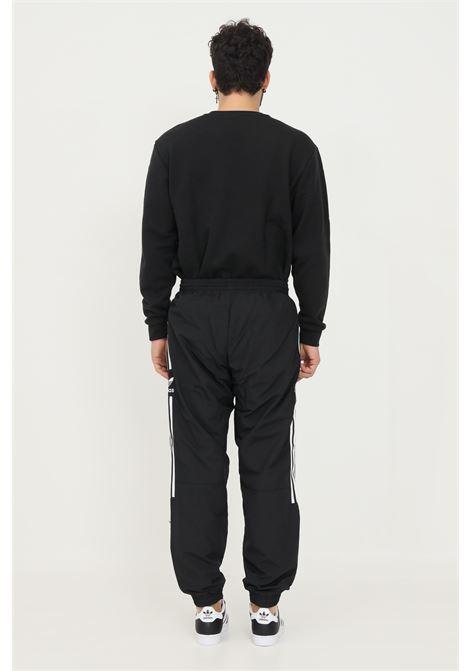 Pantaloni track pants adicolor classics lock-up trefoil uomo nero adidas sport con banda logo laterale ADIDAS | Pantaloni | H41387.