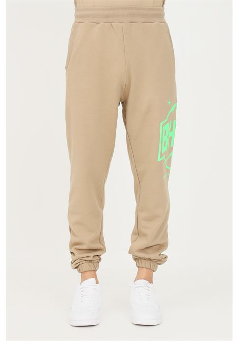 Beige unisex trousers by bhmg with side fluo logo BHMG | Pants | 031273094