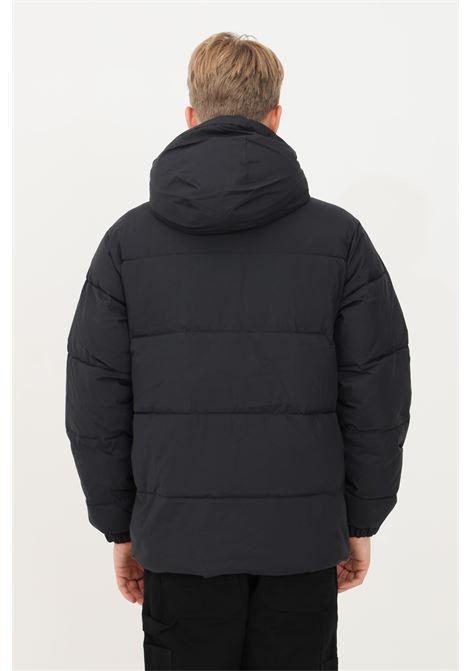 Piumino uomo nero carhartt con zip integrale e strappo CARHARTT | Giubbotti | I029449.0389.XX