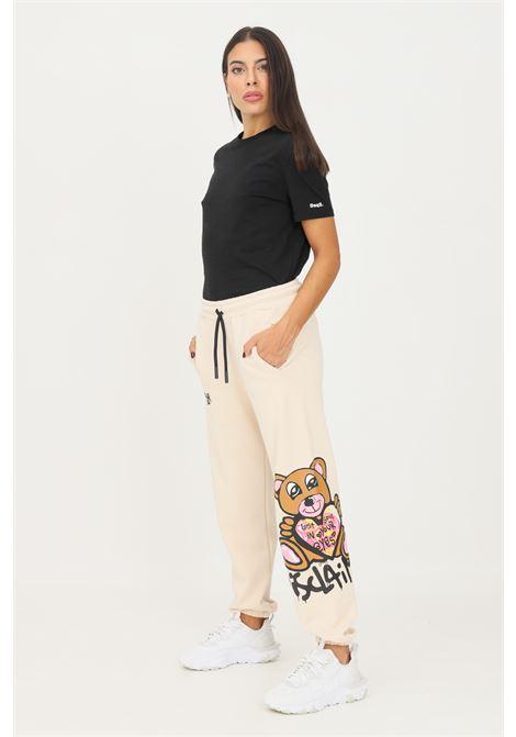 Pantaloni donna beige dislaimer casual con maxi stampa laterale DISCLAIMER | Pantaloni | 21IDS50887OFF WHITE