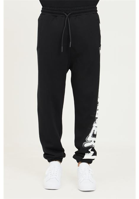 Black men's trousers by disclaimer, casual model with maxi white logo on the side DISCLAIMER | Pants | 21IDS50960NERO-BIA