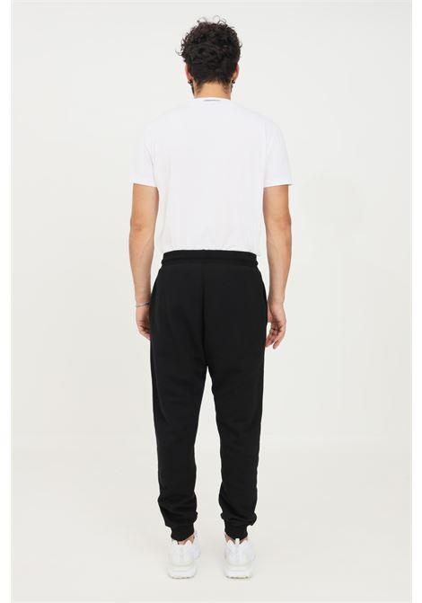 Pantaloni uomo nero gaelle modello casual con logo a contrasto GAELLE | Pantaloni | GBU4952NERO