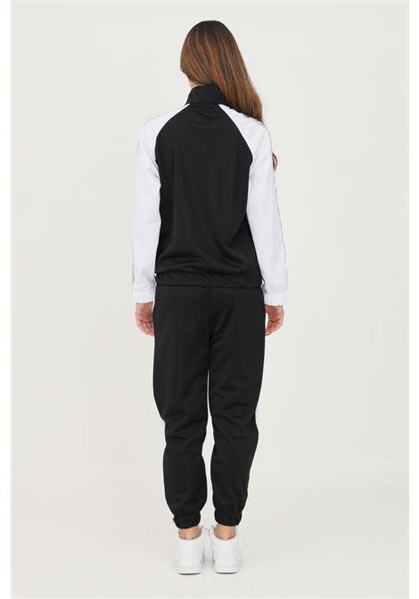 Tuta donna gioselin casual con zip e banda logo laterale GIOSELIN | Tute | TUTA BASICBIANCO-NERO
