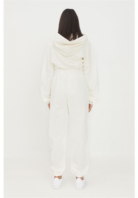 White unisex pants in solid color with contrasting logo HINNOMINATE | Pants | HNWSP38OFF WHITE