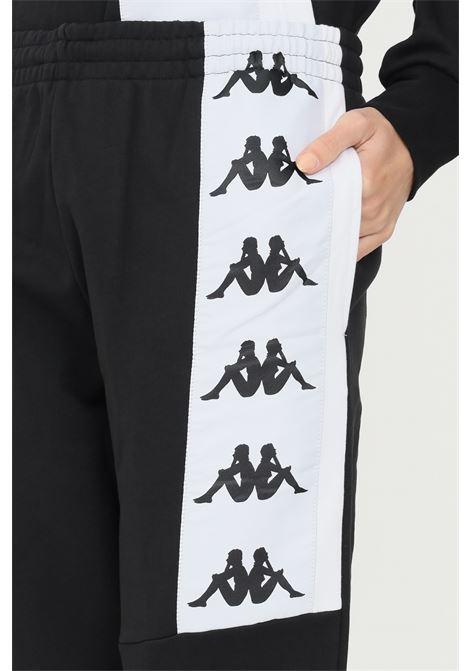 Pantaloni tuta unisex nero kappa con banda logo a contrasto KAPPA | Pantaloni | 331187WA08