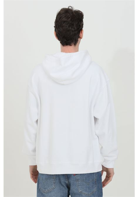 White hoodie with laces and front logo print. Relax fit model in solid color. Elastic cuffs and bottom with ribs. Levi's LEVI'S | Sweatshirt | 38479-00380038