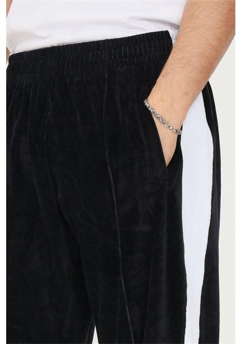 Pantaloni uomo nero make money con bande laterali a contrasto MAKE MONEY | Pantaloni | MU210003NERO/BIANCO