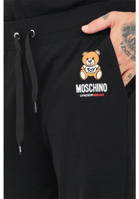 Pantaloni uomo nero moschino casual con logo frontale MOSCHINO | Pantaloni | A423481260555