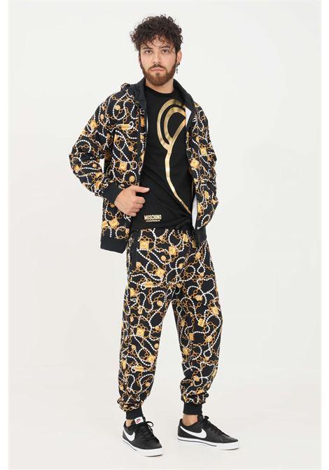 Pantaloni uomo nero moschino modello casual con stampa allover MOSCHINO | Pantaloni | A431381081555