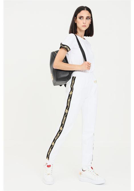 Pantaloni donna bianco moschino con rifiniture glitter in oro MOSCHINO | Pantaloni | A431790110001