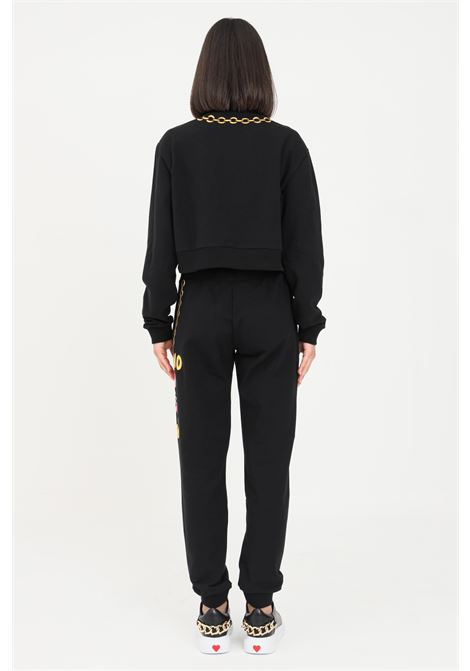 Pantaloni donna nero moschino con stampa laterale MOSCHINO | Pantaloni | A670526040555