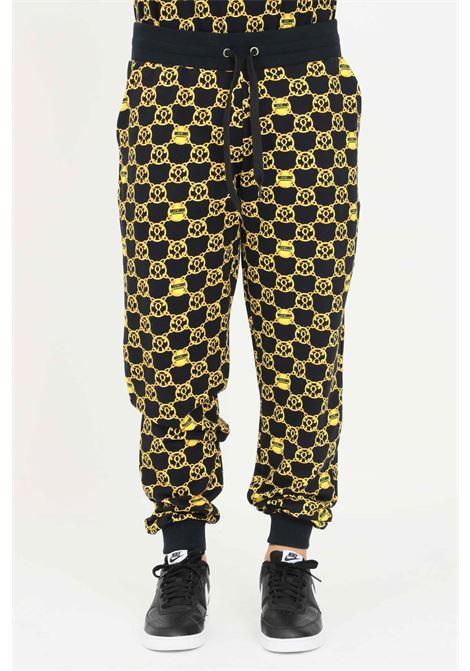 Pantaloni felpa uomo nero moschino con stampa allover MOSCHINO | Pantaloni | V432881285606