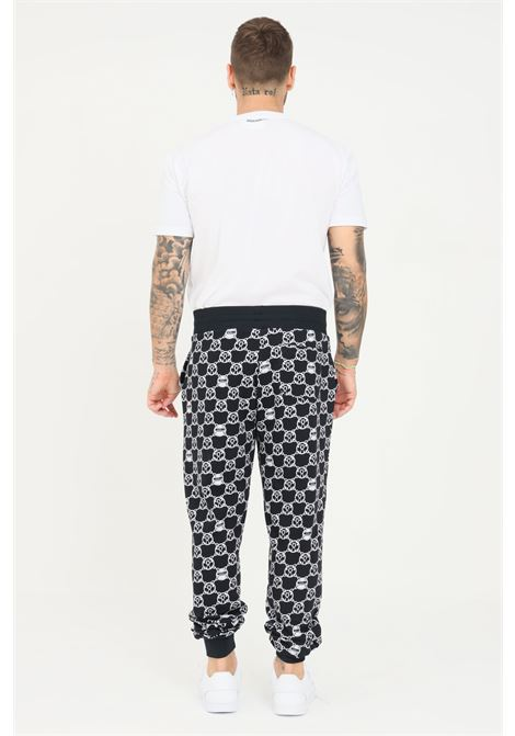 Pantaloni felpa uomo nero moschino con stampa allover MOSCHINO | Pantaloni | V432881285610