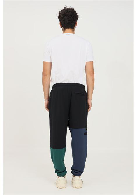 Pantaloni uomo nero new balance casual NEW BALANCE   Pantaloni   MP13503NWG335