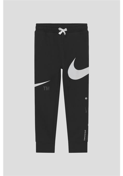 Black baby trousers by nike with contrasting logo print NIKE | Pants | 86I158023