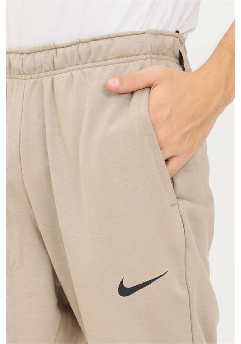 Pantaloni uomo beige nike sport NIKE | Pantaloni | CZ6379247