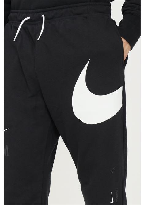 Pantaloni uomo nero nike sport con logo a contrasto NIKE | Pantaloni | DD6001010