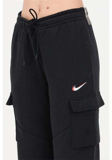 Pantaloni donna nero nike sport con logo a contrasto NIKE | Pantaloni | DJ4128010