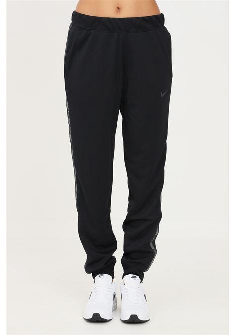 Pantaloni donna nero nike sport con bande laterali logate NIKE | Pantaloni | DM4645010