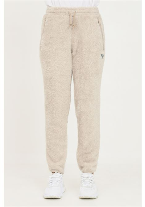 Beige women's training classic sherpa trousers by reebok REEBOK | Pants | GS9155.