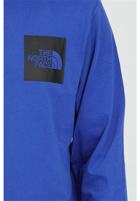 Maglia uomo blu the north face manica lunga in tinta unita con stampa logo a contrasto THE NORTH FACE   T-shirt   NF0A37FTCZ61CZ61
