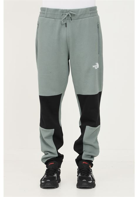 Pantaloni uomo verde the north face modello bicolore con logo a contrasto THE NORTH FACE | Pantaloni | NF0A4SWOHBS1HBS1