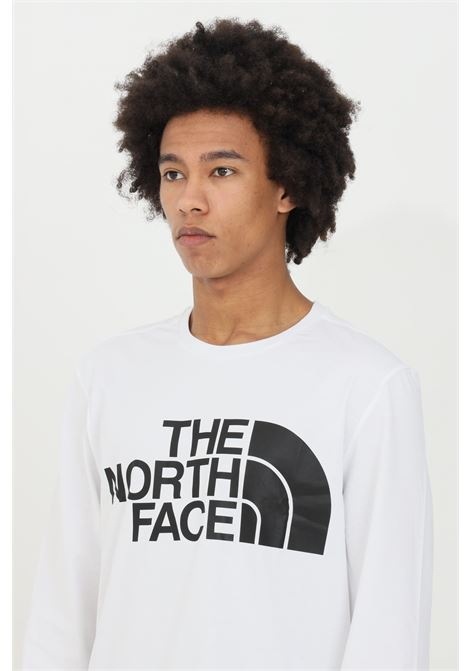 T-shirt uomo bianco the north face a manica lunga con stampa logo frontale a contrasto THE NORTH FACE   T-shirt   NF0A5585FN41FN41