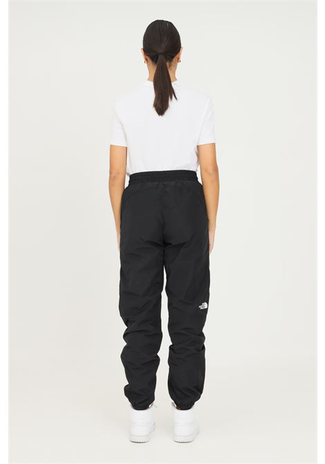 Black women's trousers by the north face, casual model with elastic waistband THE NORTH FACE | Pants | NF0A5ICGJK31JK31