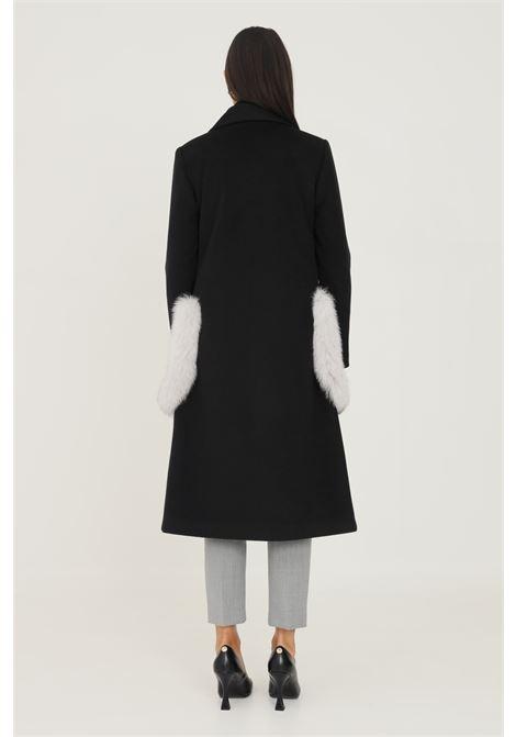 Black women's coat by un furtive, long cut with fur applications on the pockets UN_FURTIVE | Coat | CD1066NERO