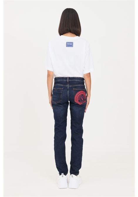 Blue women's jeans by versace jeans couture with logo print on the back VERSACE JEANS COUTURE   Jeans   71HAB5K1DW00904D904