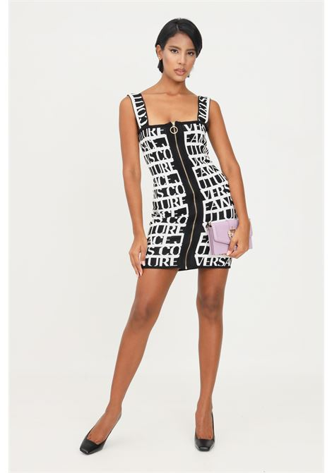 White black dress by versace jeans couture with allover lettering logo VERSACE JEANS COUTURE | Dress | 71HAO824CM03NL01 (899+003)