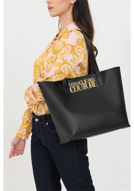 Black shopper with wallet inside. Eco-leather handles, closure with metal swivel. Metal logo lettering on the front. Versace jeans couture VERSACE JEANS COUTURE   Bag   E1VWABL871879899