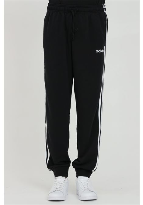 Pantaloni uomo nero adidas sport con banda laterale a contrasto ADIDAS   Pantaloni   DU0468.