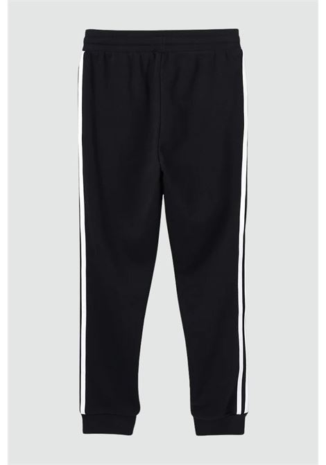 Black 3-stripes pants with elastic waistband cuffs. Baby model. Brand: Adidas ADIDAS | Pants | DV2872.
