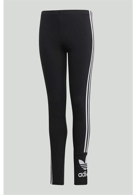 Black lock up leggings with contrasting side bands and maxi logo on the ankle. Baby model. Brand: Adidas ADIDAS | Leggings | FM5686...