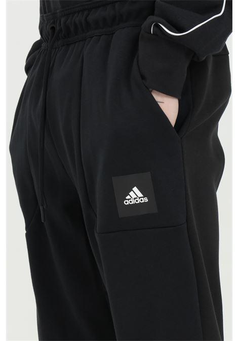 Pantaloni uomo Neri adidas must haves stadium a Tinta Unita ADIDAS | Pants | FR7160.