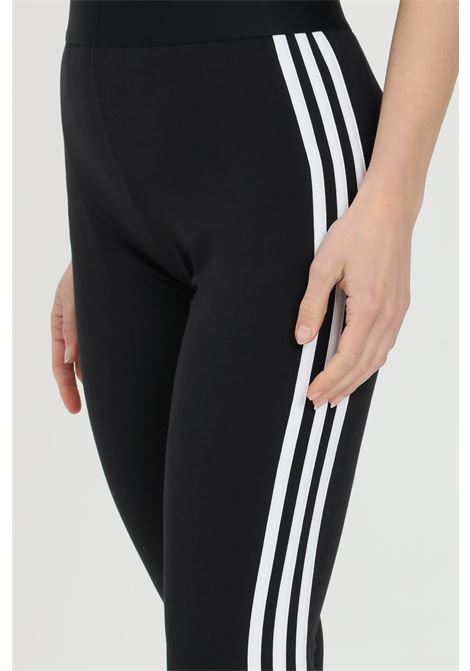 Solid color leggings with contrasting side bands and small logo on the front ADIDAS | Leggings | GL0723.