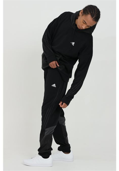 Tracksuit trousers with primegreen inserts ADIDAS | Pants | GM6489.