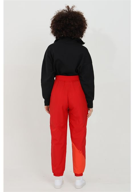Red women's track pants adicolor sliced trefoil japona trousers adidas ADIDAS | Pants | GN2826.