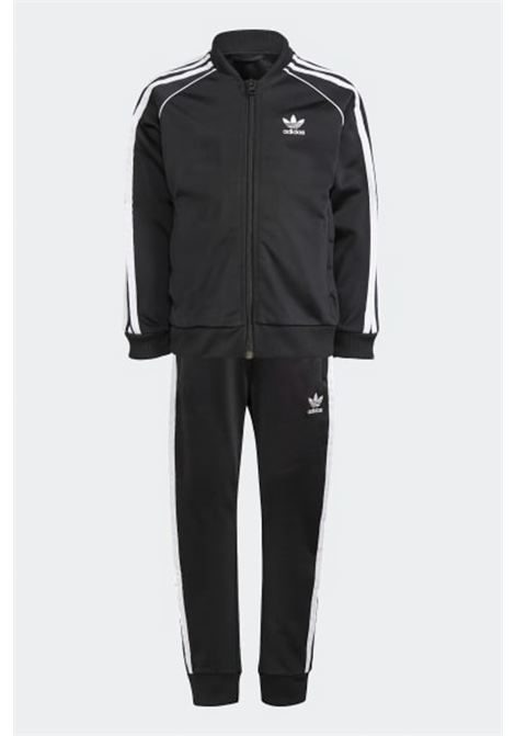 Black adicolor sst track suit, sweatshirt with zip and small logo on the front and pants with contrasting side bands. Baby model. Brand: Adidas ADIDAS | Suit | GN4362.