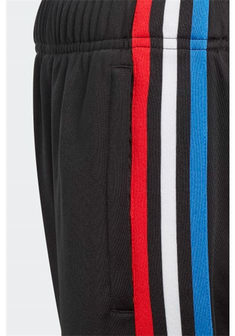 Adicolor track pants with coloured side bands, elastic waistband and cuffs. Baby model. Brand: Adidas ADIDAS | Pants | GN7485.