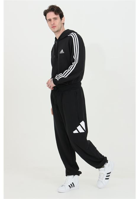 Training pants with side logo and elastic cuffs  ADIDAS | Pants | GQ6213.