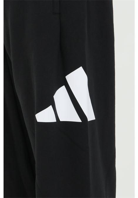 Pantaloni da allenamento con logo laterale e polsini sul fondo ADIDAS | Pantaloni | GQ6213.