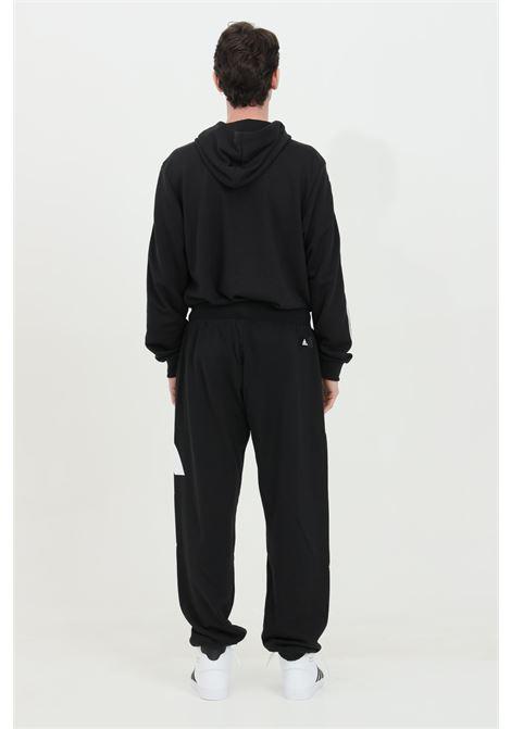 Pantaloni da allenamento con logo laterale e polsini sul fondo ADIDAS   Pantaloni   GQ6213.