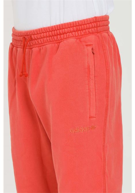 Orange trousers, sporty model. Brand: Adidas  ADIDAS | Pants | HB8050.